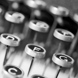 a black and white photo of typewriter keys