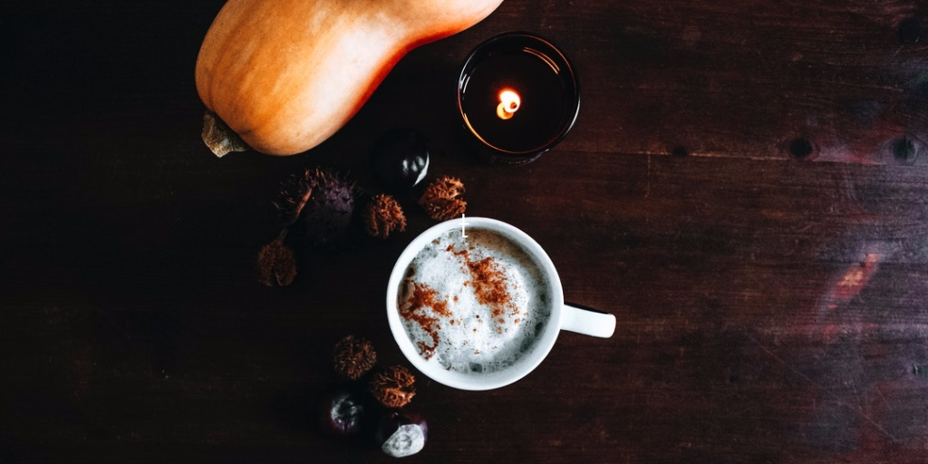 pumpkin spice latte in a latte on a table