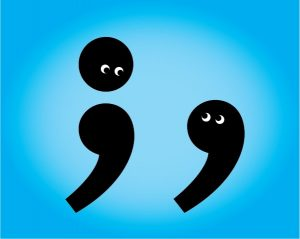 Cartoon semicolon and comma look at each other